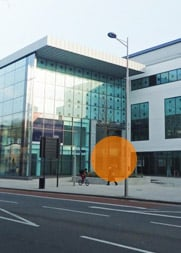 A photograph of the Bristol office building. It is opposite Hargreaves Lansdown, and the main door is highlighted.
