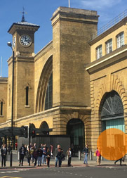 A photograph of the London office building. Seen from the front, the rightmost entrance of King's Cross Station is highlighted.